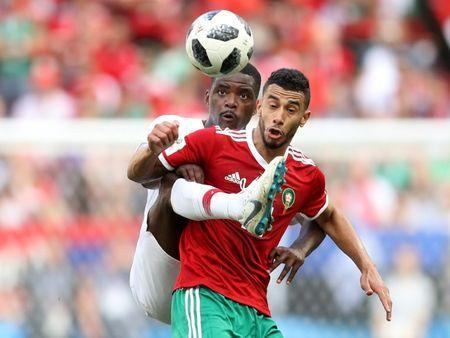 Soccer Football - World Cup - Group B - Portugal vs Morocco - Luzhniki Stadium, Moscow, Russia - June 20, 2018 Portugal's William Carvalho in action with Morocco's Younes Belhanda REUTERS/Carl Recine