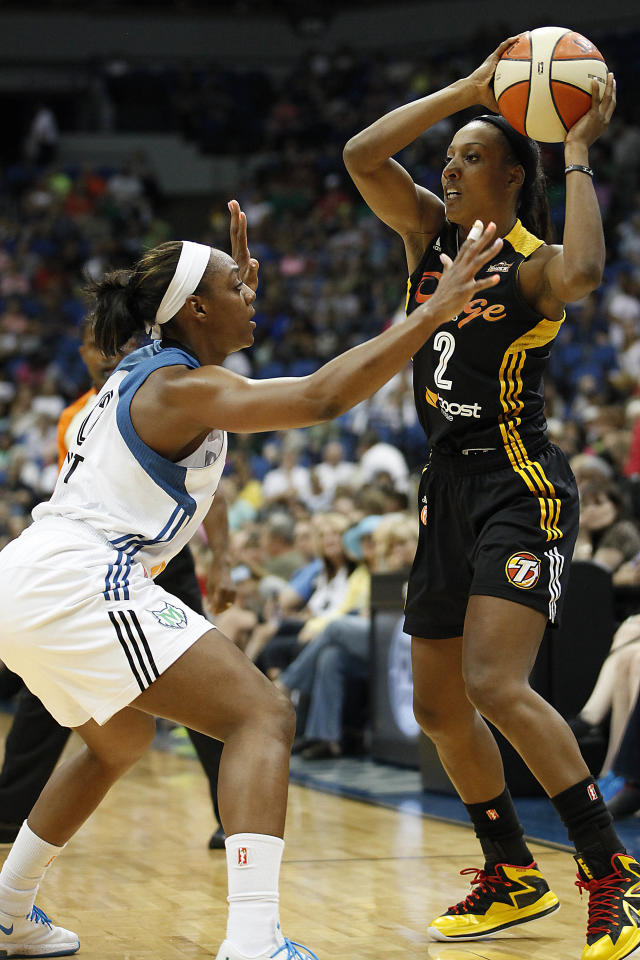 Tulsa Shock guard Candice Wiggins (2) looks to pass against Minnesota Lynx guard Monica Wright, left, in the first half of a WNBA basketball game on Friday, Aug. 16, 2013, in Minneapolis. (AP Photo/Stacy Bengs)