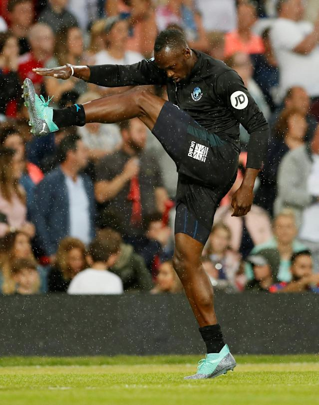 Soccer Football - Soccer Aid 2018 - England v Soccer Aid World XI - Old Trafford, Manchester, Britain - June 10, 2018 Usain Bolt before the match Action Images via Reuters/Andrew Boyers