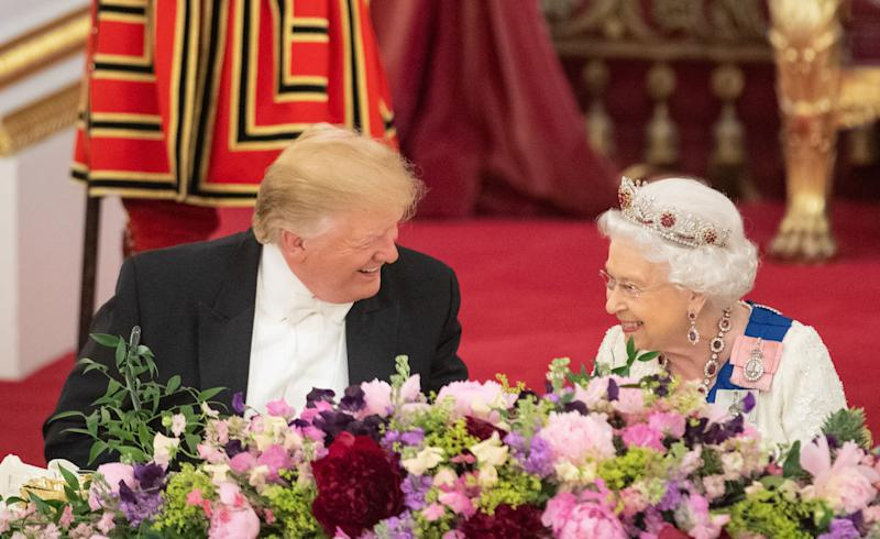 US President Donald Trump and Queen Elizabeth II during the State Banquet at Buckingham Palace, London, on day one of President Trump's three day state visit to the UK.