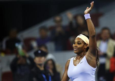 Serena Williams of the U.S. waves to the crowd after winning her women's singles semi-final match against Agnieszka Radwanska of Poland at the China Open tennis tournament in Beijing October 5, 2013. REUTERS/Kim Kyung-Hoon