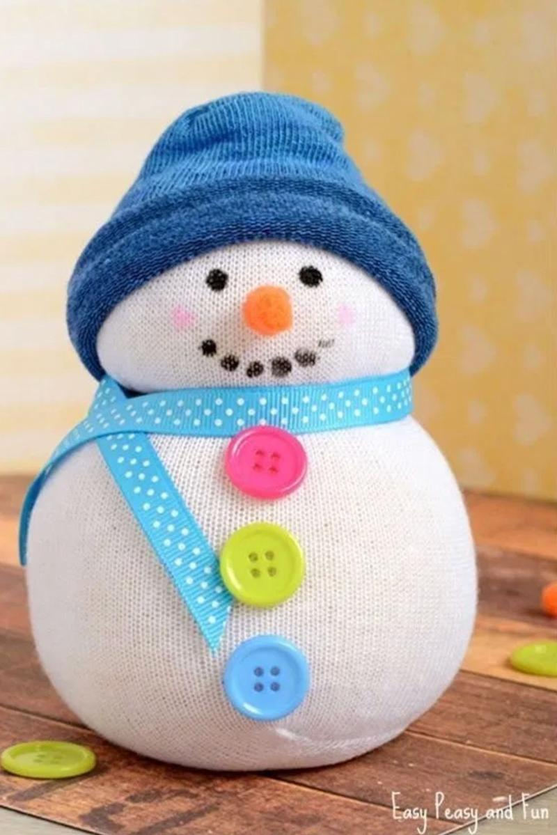 """Everyone has a bunch of loose, mismatching socks anyway. Might as well make it work. Learn how to make it at <a href=""""https://www.easypeasyandfun.com/no-sew-sock-snowman-craft/"""" target=""""_blank"""" rel=""""noopener noreferrer"""">Easy Peasy and Fun</a>."""