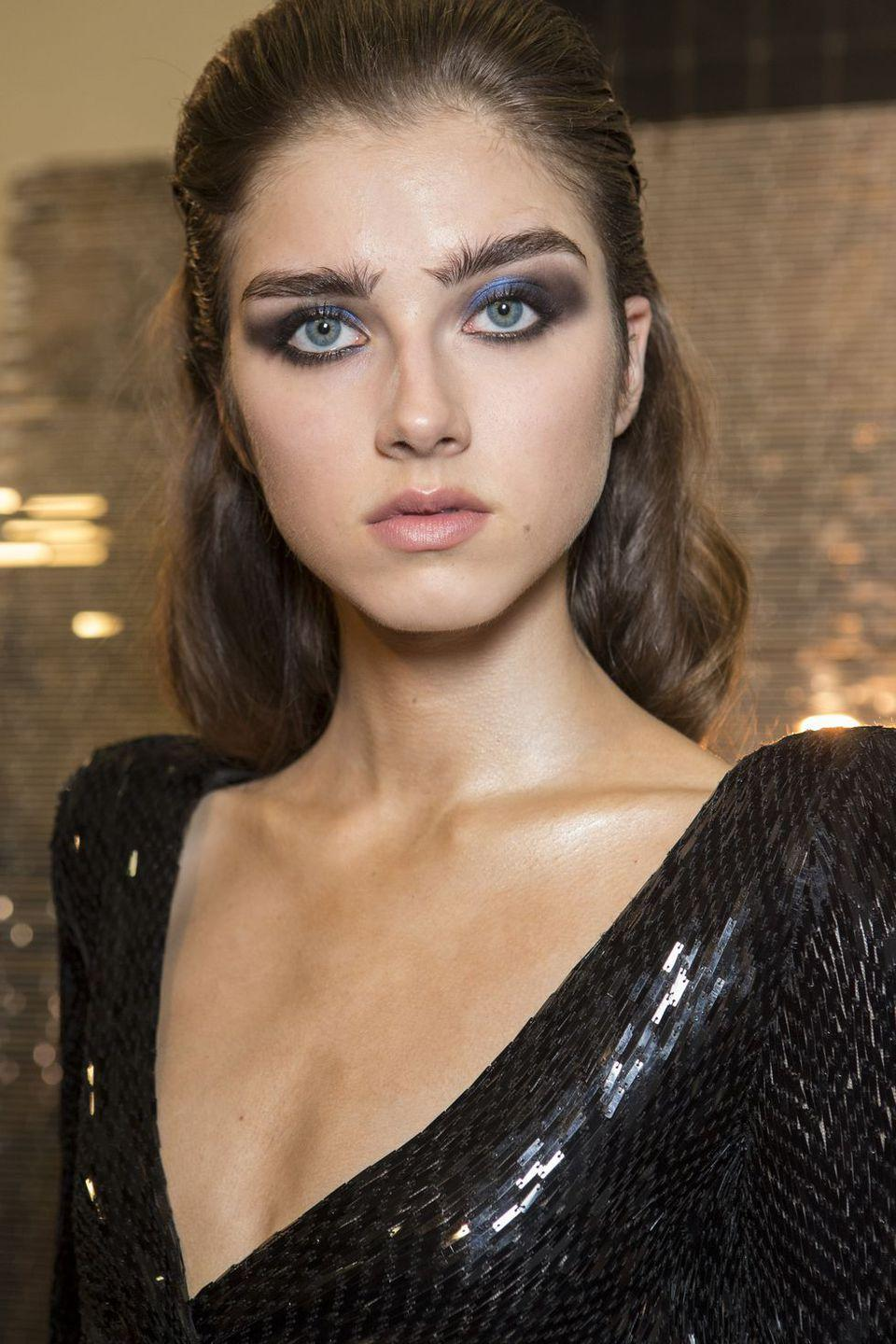 <p>A smoky eye looks fresh when a dash of metallic cobalt pigment is traces from the inner corner to the center of the lid.</p>