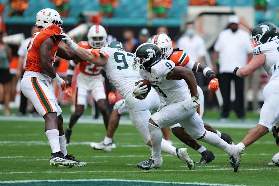 Sep 18, 2021; Miami Gardens, Florida, USA; Michigan State Spartans running back Kenneth Walker III (9) runs the ball against the Miami Hurricanes during the first half at Hard Rock Stadium.