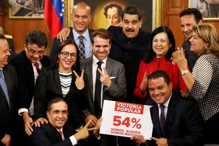 Venezuela's President Nicolas Maduro poses for a picture with new elected governors after a news conference at Miraflores Palace in Caracas