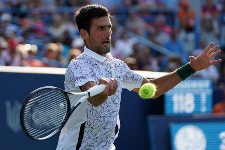 Aug 19, 2018; Mason, OH, USA; Novak Djokovic (SRB) returns a shot against Roger Federer (SUI) during the finals in the Western and Southern tennis open at Lindner Family Tennis Center. Mandatory Credit: Aaron Doster-USA TODAY Sports