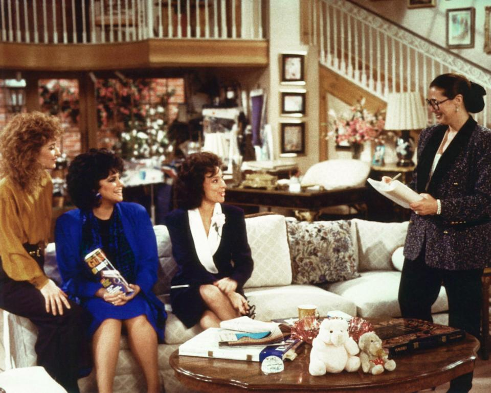 Linda Bloodworth Thomason (right) with (from left) Annie Potts, Delta Burke, and Dixie Carter on the set of <em>Designing Women</em>. (Photo: Columbia c/o Everett Collection)