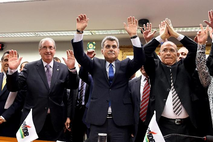 PMDB party lawmakers Eduardo Cunha (L), president of the lower chamber, Senator Romero Juca (C) and former civil aviation minister Eliseu Padilha vote to leave the government coalition (AFP Photo/Evaristo Sa)