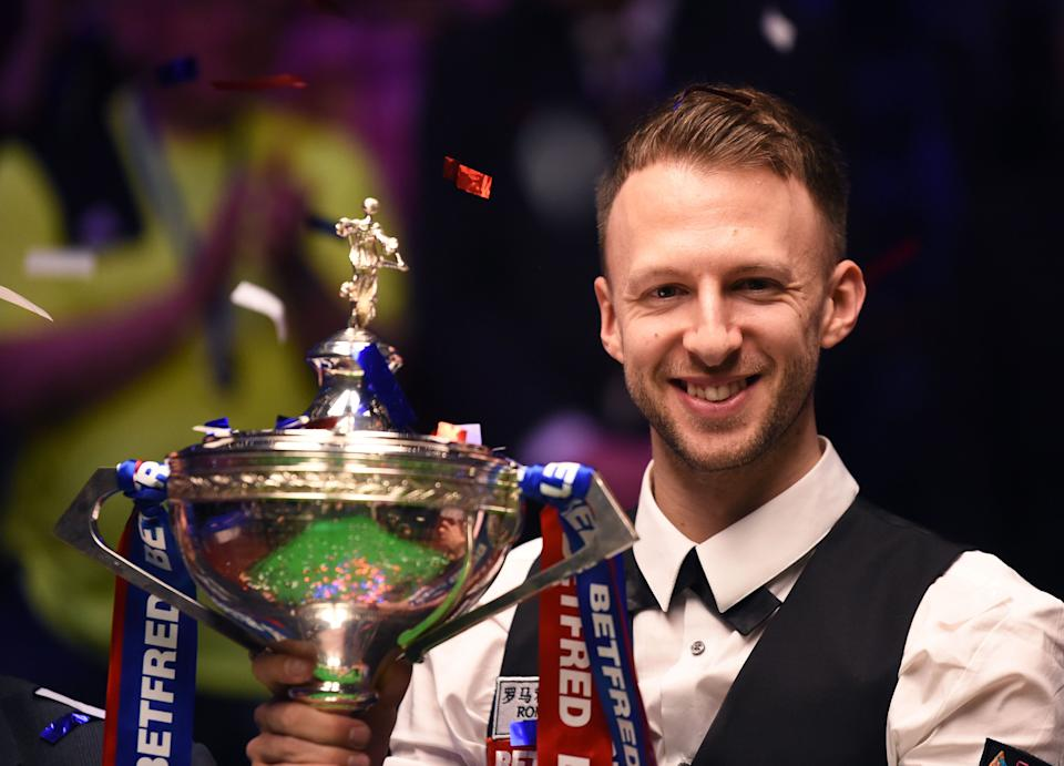 Judd Trump celebrates winning the 2019 Betfred World Snooker Championship final at Crucible Theatre (Photo by Nathan Stirk/Getty Images)
