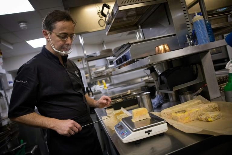 Pascal Aussignac, a Michelin starred chef, prepares takeaway foie gras at his restaurant Club Gascon in central London