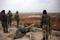 Syrian regime forces take aim at Islamic State group jihadists south of the town of Al-Bab, in the northern province of Aleppo on January 14, 2016 (AFP Photo/George Ourfalian)