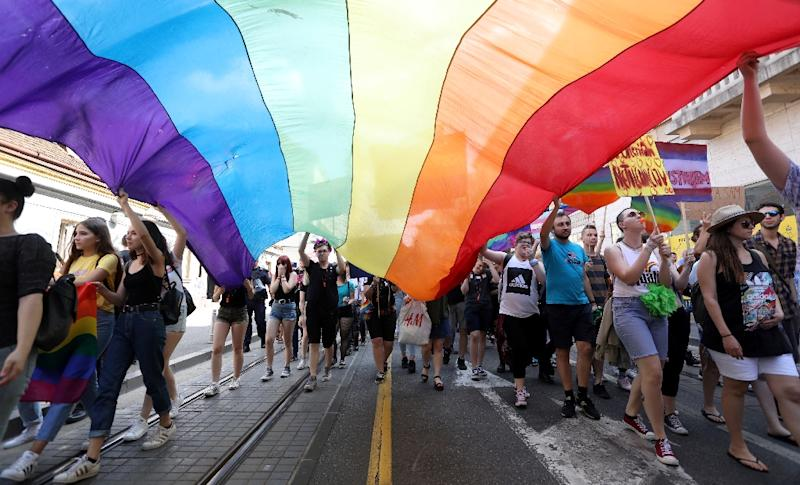 Marchers carry a rainbow flag aloft at a Gay Pride parade in Zagreb, Croatia (AFP Photo/STRINGER)