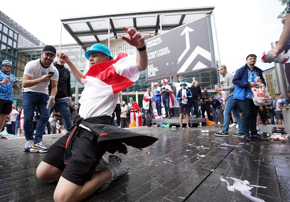 England supporters enjoy the carnival atmosphere outside Wembley (PA Wire)