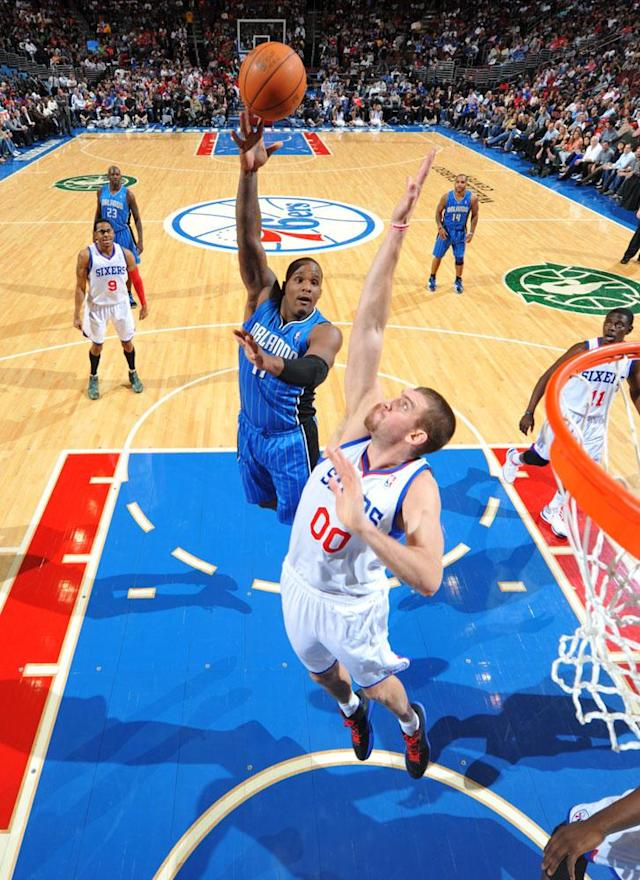 PHILADELPHIA, PA - APRIL 7: Glen Davis #11 of the Orlando Magic shoots over Spencer Hawes #00 of the Philadelphia 76ers on April 7, 2012 at the Wells Fargo Center in Philadelphia, Pennsylvania. NOTE TO USER: User expressly acknowledges and agrees that, by downloading and/or using this Photograph, user is consenting to the terms and conditions of the Getty Images License Agreement. Mandatory Copyright Notice: Copyright 2012 NBAE