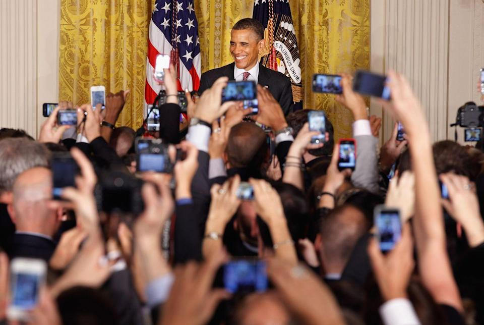 """<p>In May 2012, President Obama became the first sitting president to declare his support for same-sex marriage. Here, President Obama hosts a reception in honor of Pride Month in the East Room of the White House on June 15, 2012. </p><p>That same year, Washington state governor Christine Gregiore signed a law legalizing same-sex marriage, but her opponents delayed the law being implemented until a referendum was passed in November of that year, <a href=""""https://www.usatoday.com/story/news/politics/2015/06/24/same-sex-marriage-timeline/29173703/"""" rel=""""nofollow noopener"""" target=""""_blank"""" data-ylk=""""slk:USA Today reports"""" class=""""link rapid-noclick-resp""""><em>USA Today</em> reports</a>. In a similar battle, New Jersey's Gov. Chris Christie vetoed a bill approved by legislators to allow same-sex marriage.<br></p><p>While many states were making strides towards legalizing same-sex marriage, a judge in Nevada uphold's a ban on gay marriage in the state.</p>"""