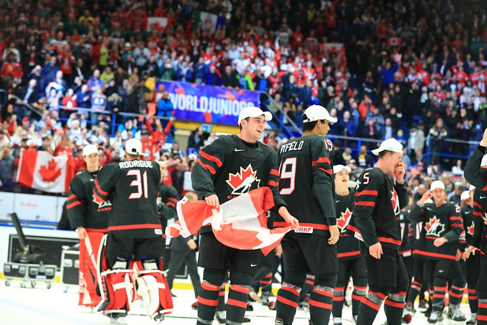 OSTRAVA, CZECH REPUBLIC - JANUARY 5, 2020: Canadian players Liam Foudy, Quinton Byfield, and Jacob Bernard-Docker (L-R front) celebrate with the trophy after the medal ceremony for the 2020 World Junior Ice Hockey Championship final match between Canada and Russia at Ostravar Arena; Canada won 4-3. Peter Kovalev/TASS (Photo by Peter Kovalev\TASS via Getty Images)