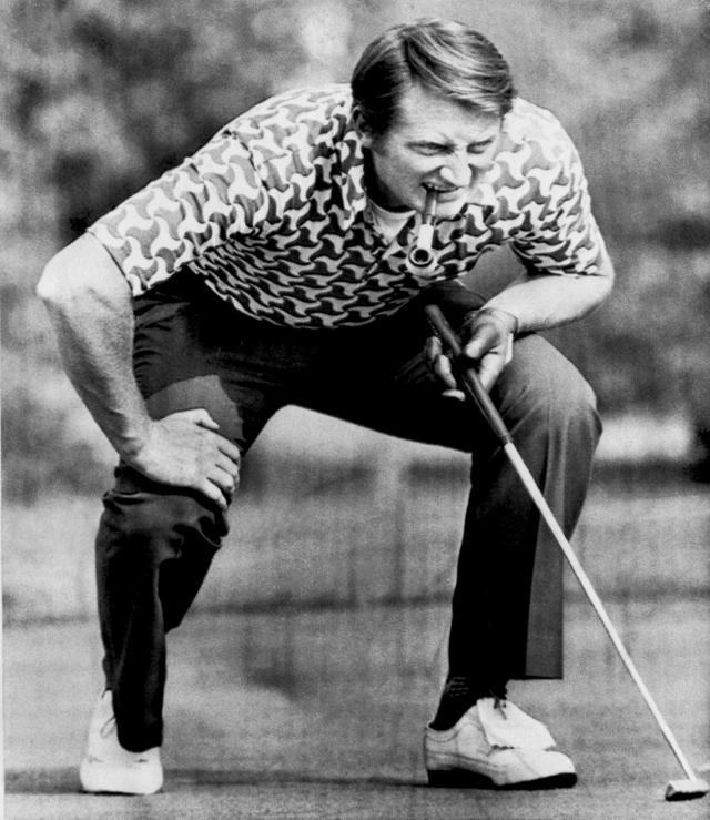 FILE - In this Friday Sept. 20, 1975 file photo, Brian Barnes of the British Ryder Cup team, pipe firmly in his mouth, lines up a putt during the fourball competition in Ligonier, Pa., during Ryder Cup golf tournament. Barnes, the charismatic English golfer who beat Jack Nicklaus twice in one day in Ryder Cup singles matches, has died after a short illness. He was 74. The European Tour said Barnes, who had cancer, died on Monday, Sept. 9, 2019 with family members by his side. (AP Photo/RAD, file)