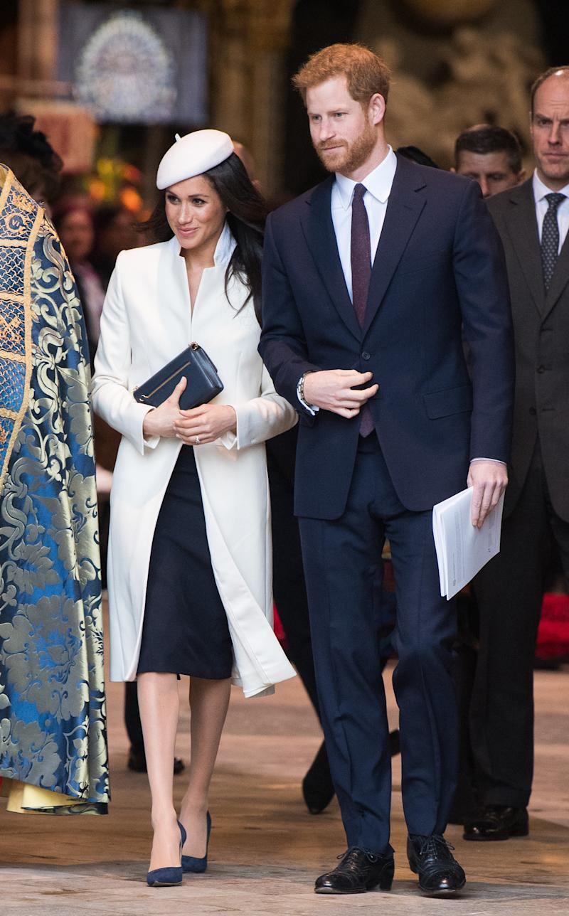 Prince Harry wore a navy suit for the occasion, as did Prince William. (Samir Hussein via Getty Images)