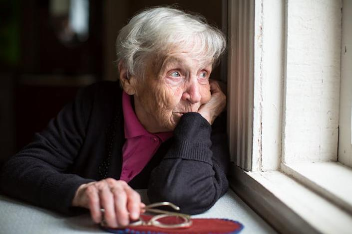 """<span class=""""caption"""">Austerity policies in the UK have meant that the safety net for old people has been eroded.</span> <span class=""""attribution""""><a class=""""link rapid-noclick-resp"""" href=""""https://www.shutterstock.com/image-photo/elderly-woman-looks-sadly-out-window-521175373"""" rel=""""nofollow noopener"""" target=""""_blank"""" data-ylk=""""slk:Shutterstock"""">Shutterstock</a></span>"""