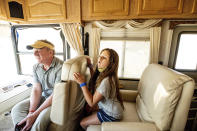 Woody and Luna Faircloth sit in a donated RV before delivering it to a Dixie Fire victim on Sunday, Sept. 5, 2021, in Sierra County, Calif. (AP Photo/Noah Berger)