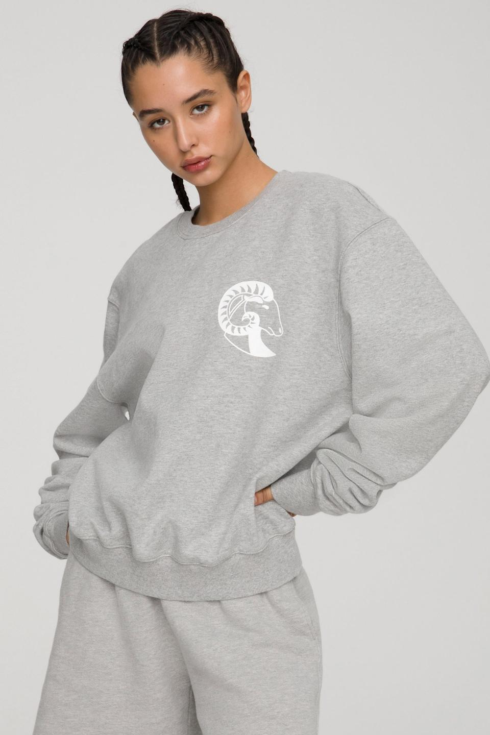 The Sagittarius Zodiac Set by Good American. Sweatshirt, $124 and sweatpants, $105.