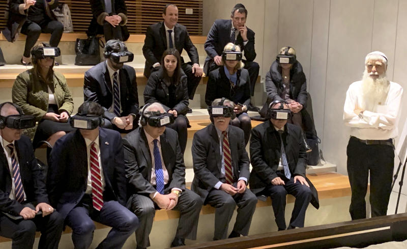 U.S. National Security Adviser John Bolton, seated front row forth from left, participates in a virtual reality demonstration at the Western Wall on Sunday, Jan. 6, 2019, in Jerusalem. U.S. Ambassador to Israel David Friedman and Israeli Ambassador to the U.S. Ron Dermer are sitting alongside. (AP Photo/Zeke Miller)