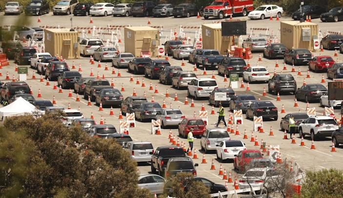 "Motorists line up for coronavirus tests at Dodger Stadium on July 8. <span class=""copyright"">(Al Seib / Los Angeles Times)</span>"