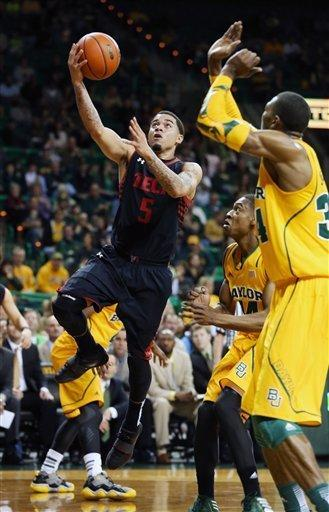 Texas Tech's Josh Gray (5), left, shoots over Baylor's Deuce Bello (14) and Cory Jefferson (34), right, in the first half of an NCAA college basketball game, Saturday, Feb. 9, 2013 in Waco, Texas. (AP Photo/Waco Tribune Herald, Rod Aydelotte)