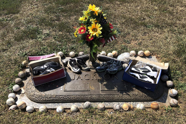 This Sept. 29, 2019, photo, shows the grave of Shoeless Joe Jackson and his wife Katie, in Greenville, S.C. (AP Photo/Paul Newberry)