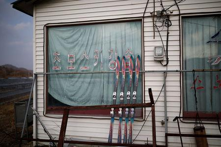 Pairs of skis are seen at an abandoned ski rental shop in front of the Alps Ski Resort located near the demilitarised zone separating the two Koreas in Goseong, South Korea, January 17, 2018. REUTERS/Kim Hong-Ji
