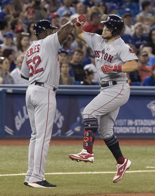 Boston Red Sox'a Michael Chavis celebrates with third base coach Carlos Pebles after hitting a three-run home run against the Toronto Blue Jays during the sixth inning of a baseball game Thursday, July 4, 2019, in Toronto. (Fred Thornhill/The Canadian Press via AP)