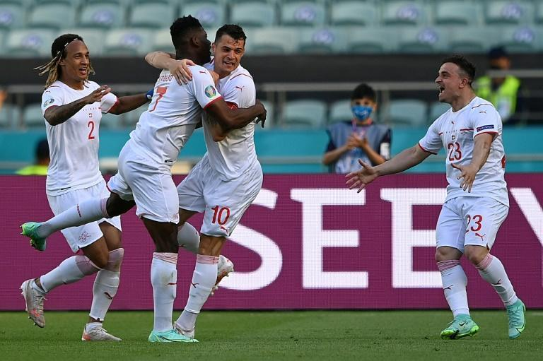 Swiss forward Breel Embolo (second from left) scored against Wales