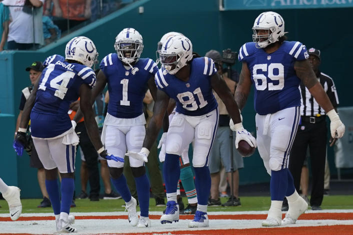 Indianapolis Colts tight end Mo Alie-Cox (81) celebrates with teammates, offensive tackle Matt Pryor (69), wide receiver Parris Campbell (1), and wide receiver Zach Pascal (14), after scoring a touchdown during the second half of an NFL football game against the Miami Dolphins, Sunday, Oct. 3, 2021, in Miami Gardens, Fla. (AP Photo/Lynne Sladky)