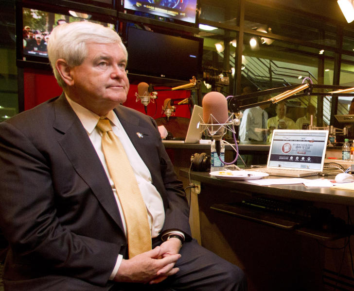 Presidential candidate, former House Speaker Newt Gingrich listens while participating in the Rick & Bubba radio show, Tuesday, March 13, 2012, in Vestavia, Ala. (AP Photo/Butch Dill)