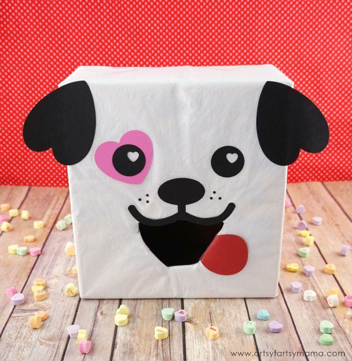 """<p>If your little one loves dogs, this puppy box is the one to make! Who can resist the heart-shaped puppy ears?</p><p><strong>Get the tutorial at</strong> <a href=""""https://www.artsyfartsymama.com/2017/02/puppy-dog-valentine-card-box.html"""" rel=""""nofollow noopener"""" target=""""_blank"""" data-ylk=""""slk:Artsy Fartsy Mama."""" class=""""link rapid-noclick-resp""""><strong>Artsy Fartsy Mama.</strong></a></p><p><a class=""""link rapid-noclick-resp"""" href=""""https://www.amazon.com/Neenah-Creative-Collection-Specialty-Cardstock/dp/B003A2I4V2/?tag=syn-yahoo-20&ascsubtag=%5Bartid%7C2164.g.35119968%5Bsrc%7Cyahoo-us"""" rel=""""nofollow noopener"""" target=""""_blank"""" data-ylk=""""slk:SHOP CARD STOCK"""">SHOP CARD STOCK</a></p>"""