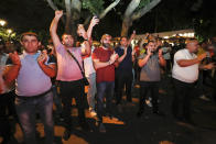 Supporters applaud for Armenian acting Prime Minister Nikol Pashinyan at the headquarters of his party after parliamentary elections in Yerevan, Armenia, Monday, June 21, 2021. Results released Monday showed that the party of Pashinyan won snap parliamentary elections which he called to ease anger over a peace deal he signed with Azerbaijan. (Tigran Mehrabyan/PAN Photo via AP)