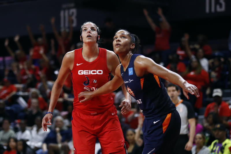Washington Mystics forward Elena Delle Donne, left, and Connecticut Sun forward Alyssa Thomas watch a free throw attempt in the second half of Game 1 of basketball's WNBA Finals, Sunday, Sept. 29, 2019, in Washington. (AP Photo/Patrick Semansky)