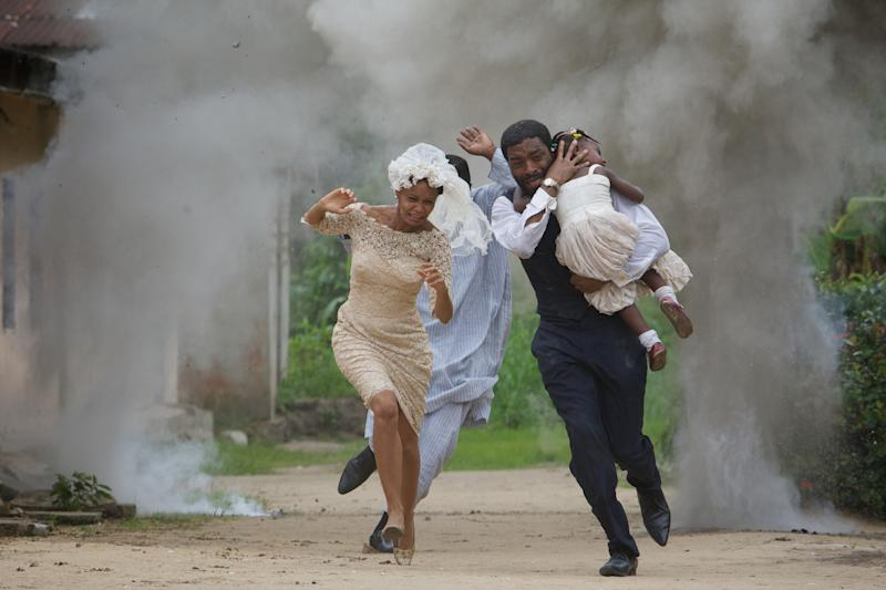 """In this Thursday, May, 17. 2012 photo released by Yellow sun ltd, actress Thandie Newton, left, and actor Chiwetel Ejiofor, right, act in a film ''Half of a yellow sun'' an adaptation of novelist Chimamanda Ngozi Adichie's book, in Calabar, Nigeria. The film stars an Oscar nominee, is set in Nigeria during a civil war, is based on an award-winning novel and the head of Nigeria's censorship board reportedly loved it. Yet a week after the scheduled premiere of """"Half of a Yellow Sun,"""" it still has not been shown in any theater in Nigeria. Nigerian government censors are effectively banning the film but they will not say why, director Biyi Bandele told The Associated Press on Thursday. He spoke in a telephone interview from his home in London, where the movie placed among the 10 most popular at cinemas over the Easter weekend. It debuts in the U.S. on May 16. It hasn't opened in Nigeria yet because the censors may fear it could stoke tribal rivalries. The board hasn't issued an explanation. The movie stars Oscar nominee Chiwetel Ejiofor (""""12 Years a Slave"""" - the 2014 best picture Oscar) and Thandie Newton and is an adaptation of the book by Chimamanda Ngozi Adichie. It is partly set during the 1967-1970 civil war when the southeast sought to break away from the federation, and it comes at a time when Nigeria is threatened by an Islamic uprising in the northeast, jeopardizing unity between the mainly Muslim north and predominantly Christian south. A ban on the movie would perpetuate the conspiracy of silence that has kept Nigerians from discussing the civil war, a subject that was pointedly excluded from history lessons in schools, Bandele said. (AP Photo/ Yellow Sun Ltd)"""