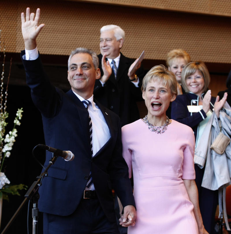 Chicago mayor-elect Rahm Emanuel, left, and his wife Amy Rule acknowledge the crowd during inaugural ceremonies Monday, May 16, 2011 in Chicago. (AP Photo/Charles Rex Arbogast)