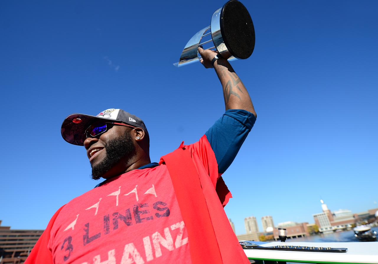 BOSTON, MA - NOVEMBER 2:  David Ortiz #34 of the Boston Red Sox holds up his World Series MVP trophy during a victory parade on November 2, 2013 through Boston, Massachusetts. (Photo by Michael Ivins/Boston Red Sox/Getty Images)