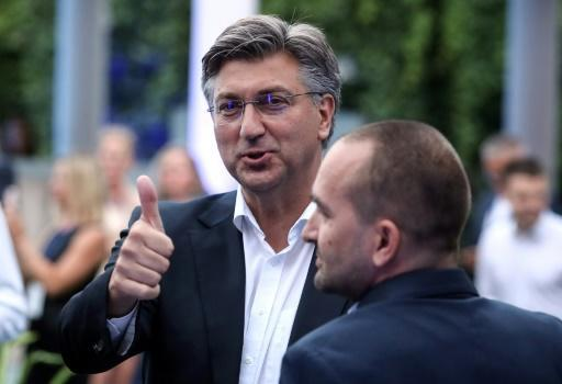 Croatian Prime Minister and leader of the HDZ party Andrej Plenkovic (C) was presented as a safe pair of hands to tackle economic fallout from the pandemic
