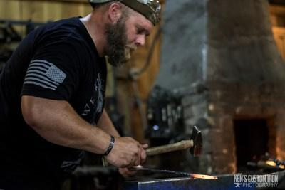"Injured veterans had the opportunity to learn blacksmithing alongside other veterans from Wounded Warrior Project® (WWP) at Ken's Custom Iron in Avon, Minn. The shop donated the class and prepared lunch for the group. ""When you take steel and heat it up to shape it, you're getting outside of your own mind -- you're focusing on the piece of metal and using all your senses to focus on just that."""