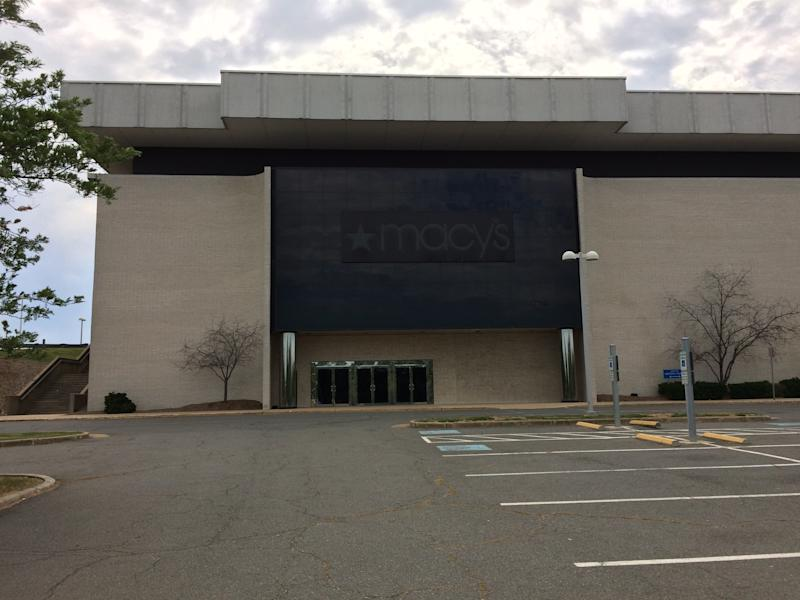 The exterior of a vacant former Macy's store.