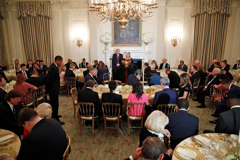 President Donald Trump bows his head in prayer as pastor Paula White leads the room in prayer during a dinner for evangelical leaders in the State Dining Room of the White House, Monday, Aug. 27, 2018, in Washington, D.C. (Photo: Alex Brandon / ASSOCIATED PRESS)