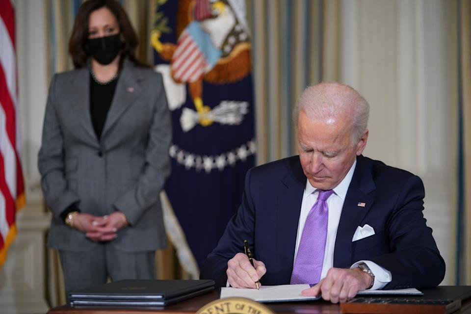 US Vice President Kamala Harris watches as Biden signs executive orders after speaking on racial equity. Source: Getty