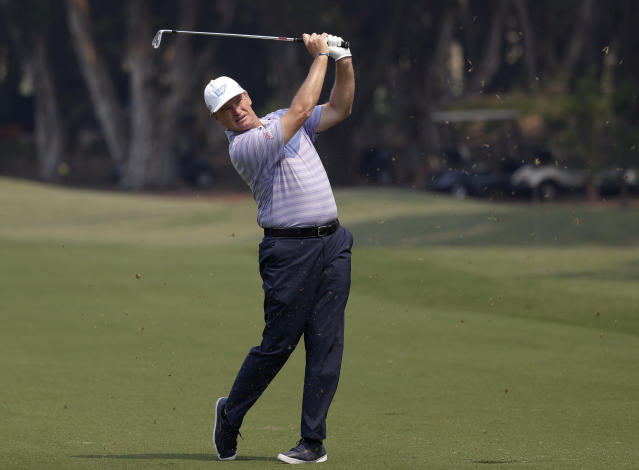 South Africa's Ernie Els plays his second shot on the first hole during the Australian Open Golf Pro-AM in Sydney, Wednesday, Dec. 4, 2019. The Australian Open begins Thursday. (AP Photo/Rick Rycroft)