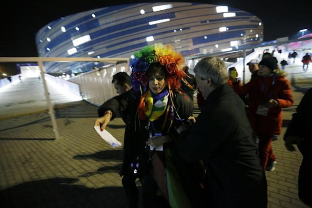 Vladimir Luxuria, a former Communist lawmaker in the Italian parliament and prominent crusader for transgender rights, is detained by police after entering the Shayba Arena at the 2014 Winter Olympics, Monday, Feb. 17, 2014, in Sochi, Russia. (AP Photo/David Goldman)