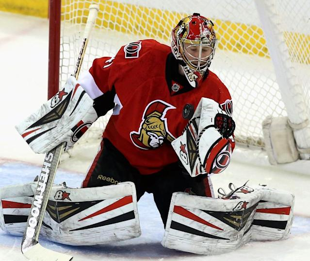 Ottawa Senators goaltender Craig Anderson (41) makes a glove save during the first period of an NHL hockey game against the Nashville Predator, Monday, March 10, 2014, in Ottawa. (AP Photo/The Canadian Press, Fred Chartrand)