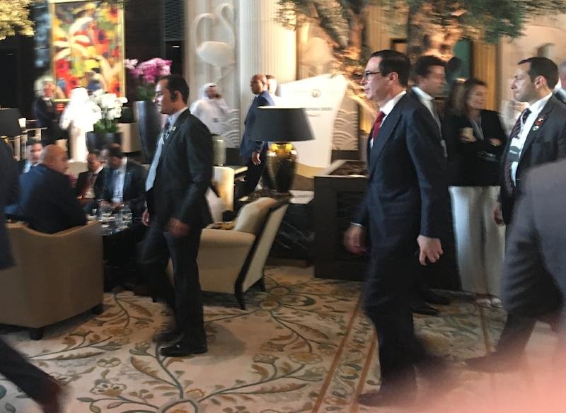 US Treasury Secretary Steven Mnuchin (second to right) arrives at the Peace to Prosperity workshop in the Bahraini capital Manama, flanked by security guards (AFP Photo/Shaun TANDON)