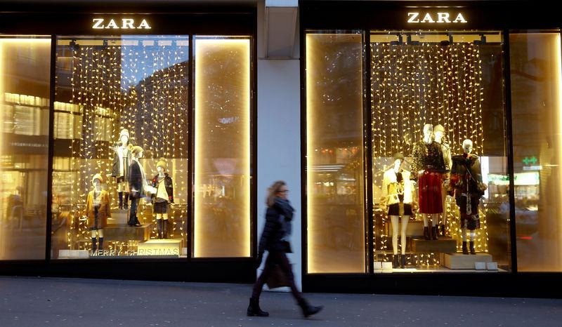 Christmas decorations are seen in the windows of a Zara clothing store in Zurich